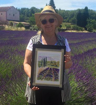 Brenda Sleightholme holding her painting